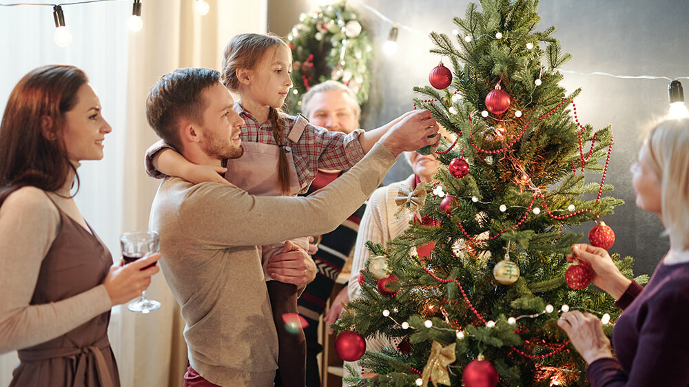 Alsip Real Christmas Tree Care family decorating christmas tree together