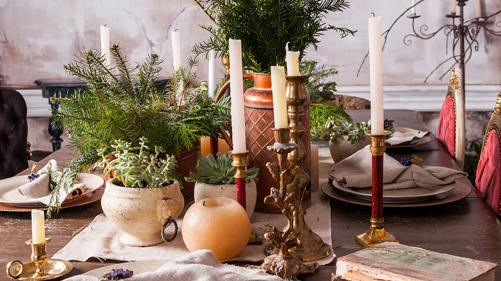 Alsip Nurseries candles and greenery on dining table for Christmas