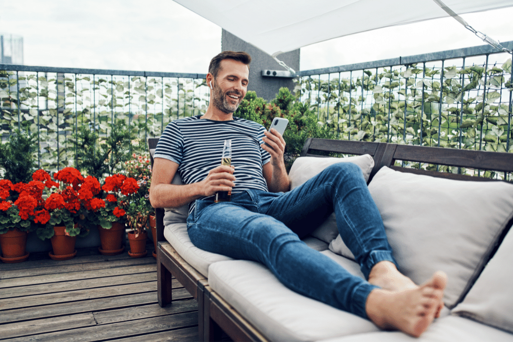man relaxing with a beer on comfy patio furniture under the sun alsip nurseries