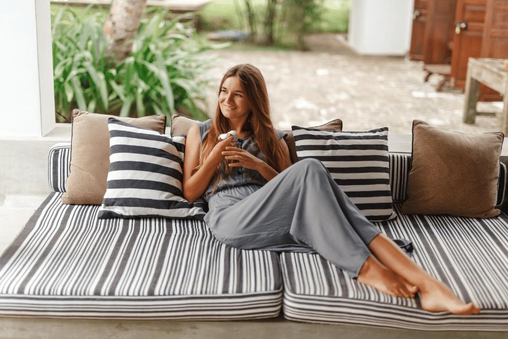 woman sitting on beautiful patio furniture in the summertime alsip nurseries