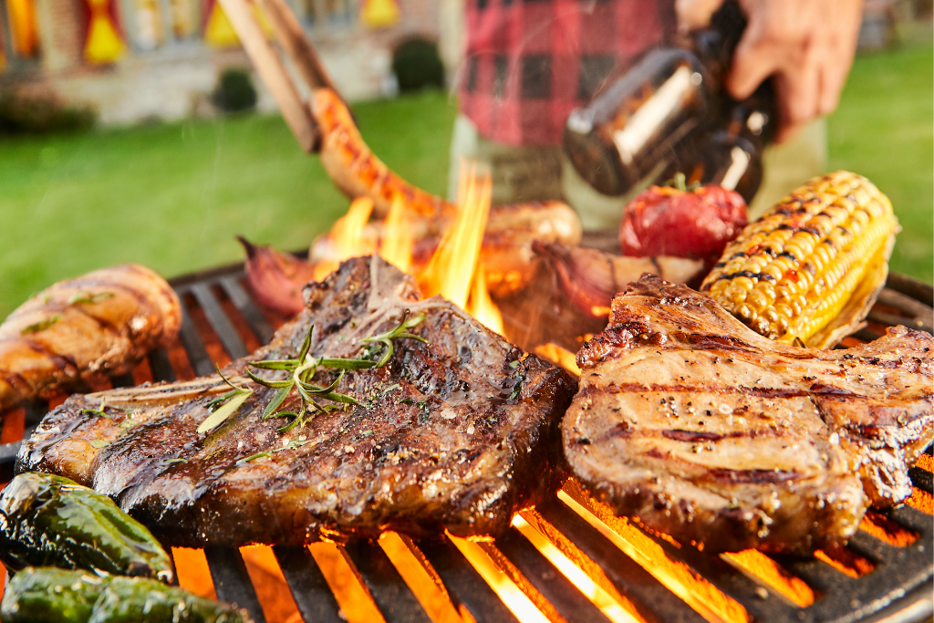 up close shot of yummy steaks and chicken being grilled on the bbq fathers day dinner ideas alsip nurseries