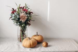 Alsip Nursery pumpkins and flowers in vase